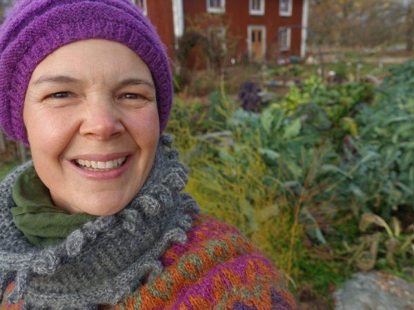 Sara Backmo stands in her kitchen garden