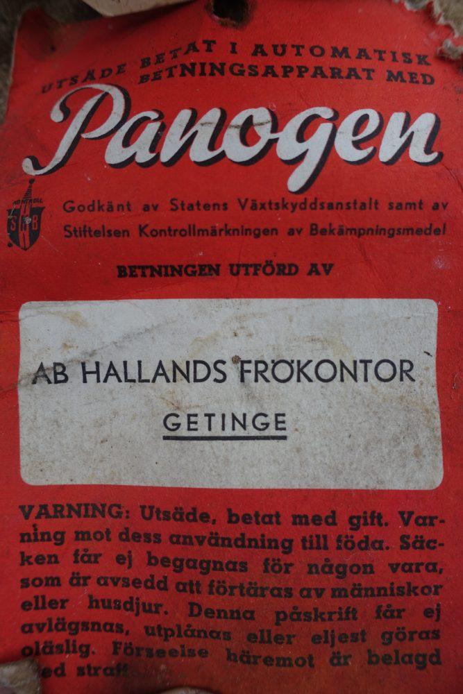 Närbild på en varningstext om Pantogen.